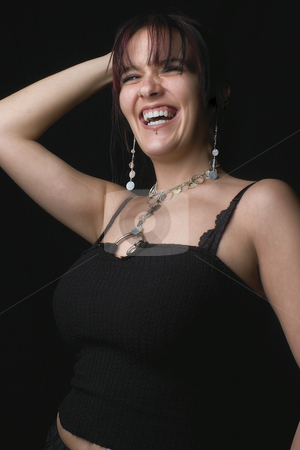 Fashion model - laughing stock photo, Twenty something fashion model in full hearted laugh while posing by Yann Poirier