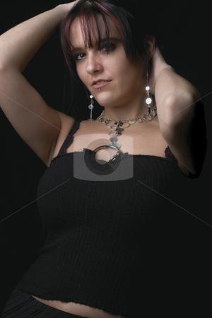 Fashion model - Holding hair stock photo, Twenty something fashion model holding hair by Yann Poirier