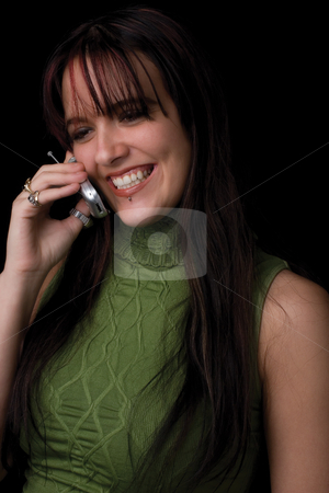 Fashion model - big smile on cell stock photo, Twenty something fashion model holding cell phone with big smile by Yann Poirier