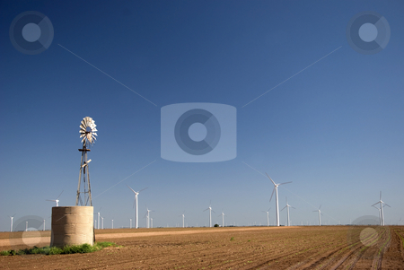Good Idea Better Idea stock photo, Wind were used to pump water, now wind is used to produce electricity. by Charles Buegeler