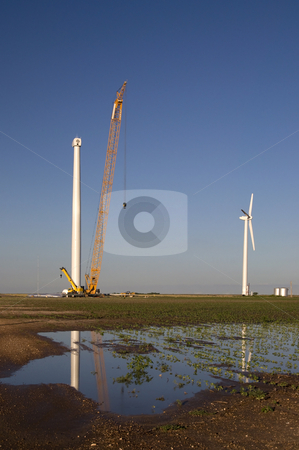 Cotton Field Reflections stock photo, A new wind turbine under construction reflection in the water. by Charles Buegeler