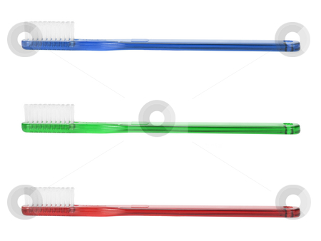 Toothbrushes stock photo, A blue, a green and a red toothbrush isolated on white background. by Ignacio Gonzalez Prado