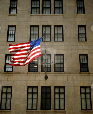 American flag stock photo, An American flag waving on the facade of a building. by Ignacio Gonzalez Prado