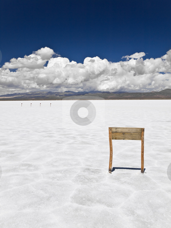 Wooden sign in salt sea stock photo, A wooden sign nailed in a huge salt field. by Ignacio Gonzalez Prado