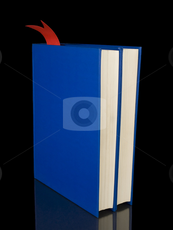 Two blue books stock photo, Two blue books isolated on black background. by Ignacio Gonzalez Prado