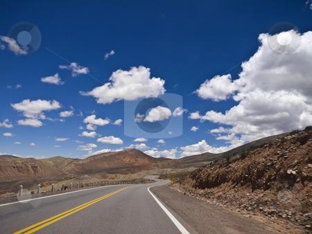 Curves ahead stock photo, A winding road ahead. Small motion blur. by Ignacio Gonzalez Prado
