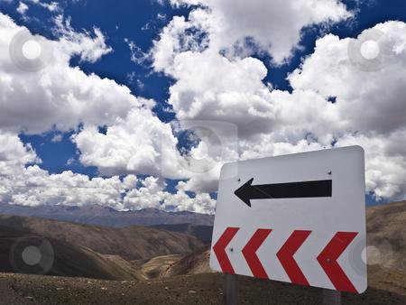 Go left stock photo, A TURN sign over the hill. Flip it to go right. by Ignacio Gonzalez Prado