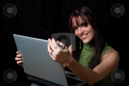 Fashion model - Working on laptop stock photo, Twenty something fashion working on laptop while sitting by Yann Poirier