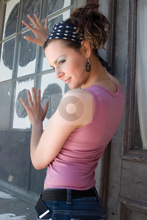 Urban teen girl stock photo, Twenty something teen girl hanging around a old building window by Yann Poirier
