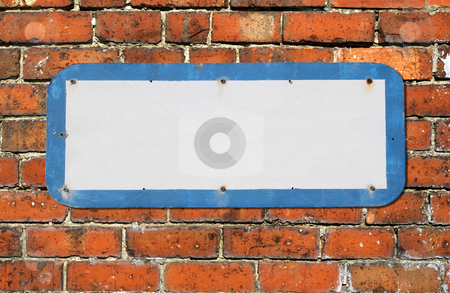 Old blank sign on a red brick wall. stock photo, Old blank sign on a red brick wall. by Stephen Rees