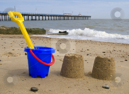 Kids bucket, spade and sandcastles on Felixstowe beach. stock photo, Kids bucket, spade and sandcastles on Felixstowe beach. by Stephen Rees