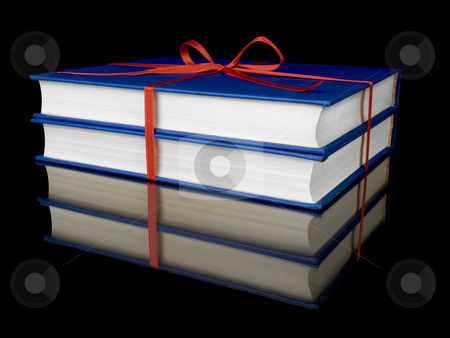 Two blue books stock photo, Two blue books with red silk ribbon, isolated on black background. by Ignacio Gonzalez Prado