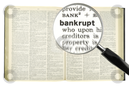 Dictionary search stock photo, A magnifying glass on the word BANKRUPT on a dictionary. by Ignacio Gonzalez Prado
