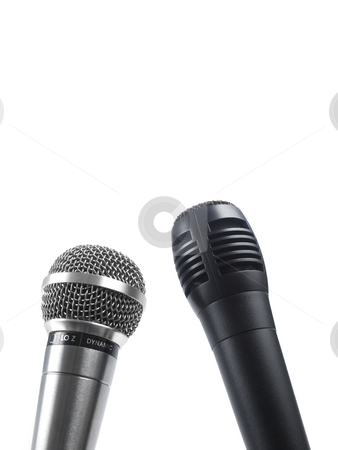 Two mics stock photo, A black and a silver microphones isolated with copyspace. by Ignacio Gonzalez Prado