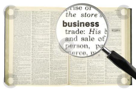 Dictionary search stock photo, A magnifying glass on the word BUSINESS on a dictionary. by Ignacio Gonzalez Prado