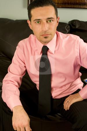 Businessman Looking at the Camera stock photo, Close up on a Businessman Looking at the Camera by Mehmet Dilsiz