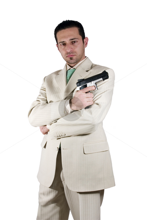 Mafia with arms crossed and a gunon hand stock photo, Isolated Mafia with arms crossed and a gunon hand by Mehmet Dilsiz