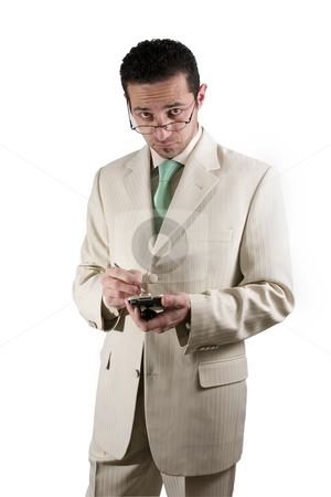 Businessman with PDA looking over his glasses stock photo, Concerned businessman on PDA looking over his glasses by Mehmet Dilsiz