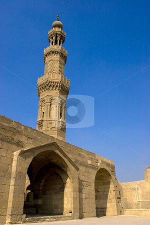 The Minaret of Zuweila stock photo, Bab Zuweila is a medieval gate in Cairo, which is still standing in modern times. It was also known as Bawabbat Al-Mitwali during the Ottoman period, and is sometimes spelled Bab Zuwayla. It considered the last remaining southern gate from the walls of Fatimid Cairo in the 11th and 12th century. Its name comes from Bab, meaning