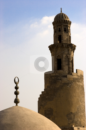 The Minaret of Ibn Tulun stock photo, The Mosque of Ahmad Ibn ?ulun is located in Cairo, Egypt. It is arguably the oldest mosque in the city surviving in its original form, and is the largest mosque in Cairo in terms of land area. The mosque was commissioned by Ahmad Ibn Tulun, the Abbassid governor of Egypt from 868 by Amr Hassanein