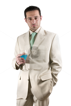 Businessman celebrating with a glass of drink in a white suit stock photo, Isolated businessman celebrating with a glass of drink by Mehmet Dilsiz