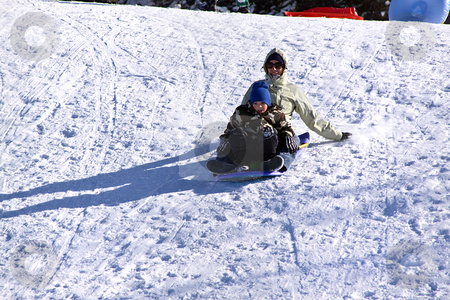 Mom and Son Sledding down the Hill stock photo, Mother and Son Sledding down the Hill - Winter Scenes by Mehmet Dilsiz