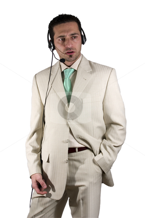 Businessman closing a deal on the headset phone stock photo, Isolated Businessman with headset closing a deal in white suit by Mehmet Dilsiz