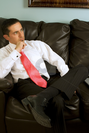 Businessman Sitting on the Couch stock photo, Businessman Sitting On the Couch Looking Up by Mehmet Dilsiz
