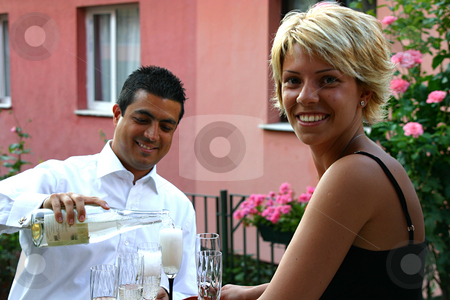 Young Beautiful Couple Celebrating stock photo, Young Beautiful Couple Celebrating with Champagne by Mehmet Dilsiz