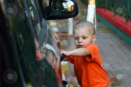 I'm getting the Door stock photo, Little Boy Unlocking the Car Door by Mehmet Dilsiz