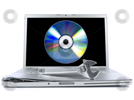 Fixing tools stock photo, Damaged laptop with a spanner over it and a digital disc on the screen. Isolated on white. by Ignacio Gonzalez Prado