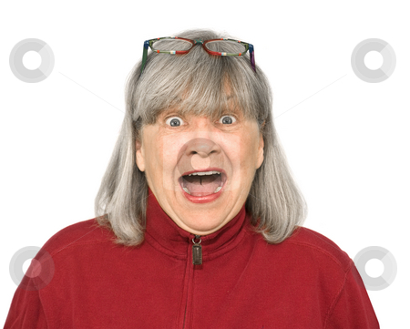 Senior woman yelling stock photo, Senior woman yelling on a white background by John Teeter