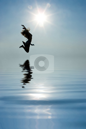 Girl jumping high stock photo, Girl in high jump over the sea by Dmitry Rostovtsev