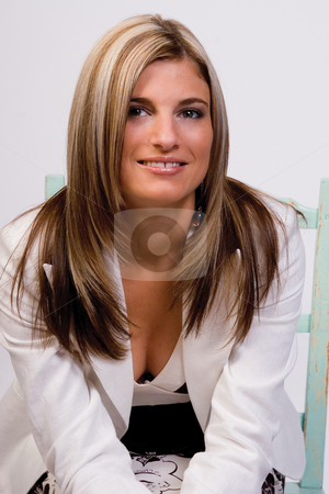 Casual business women stock photo, Women in casual business attire sitting on a green chair by Yann Poirier