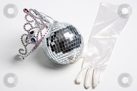 Prom party essential stock photo, What every prom party should have, disco ball, jeweled tiara and some fancy clothing by Yann Poirier