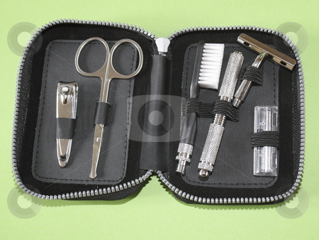 A small travel kit stock photo, Pocket size travel kit with scissors nail clippers toothbrush and razor by Mike Smith