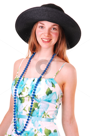 Young lady with hat. stock photo, Beautiful young woman in a blue and green dress and pearl chain with  an big black straw hat, smiling and looking in the camera, over white. by Horst Petzold