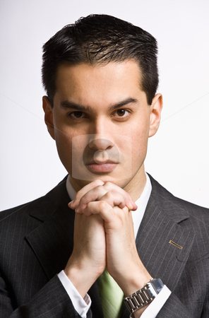 Serious businessman with hands clasped stock photo, Serious businessman with hands clasped by Jonathan Ross