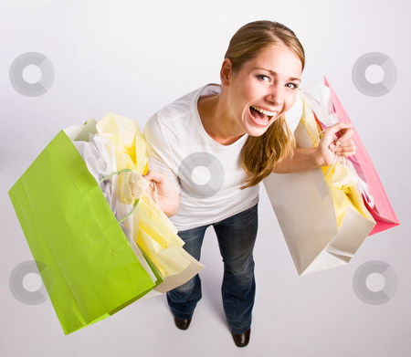 Woman holding shopping bags stock photo, Woman holding shopping bags by Jonathan Ross