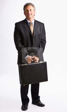 Businessman carrying briefcase stock photo, Businessman carrying briefcase by Jonathan Ross