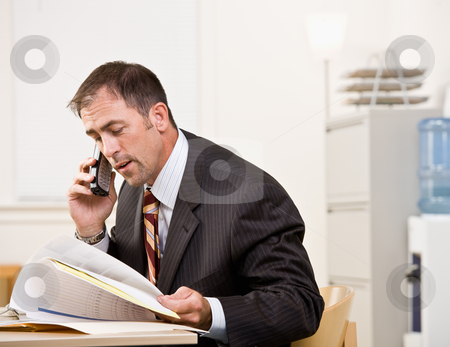 Businessman talking on telephone stock photo, Businessman talking on telephone by Jonathan Ross