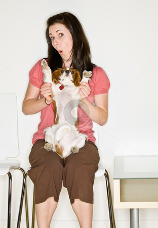 Woman playing with dog in waiting room stock photo, Woman playing with dog in waiting room by Jonathan Ross