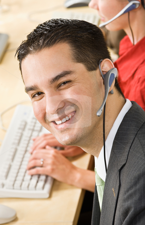 Businessman talking on headsets stock photo, Businessman talking on headsets by Jonathan Ross