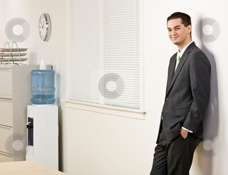 Businessman leaning on wall stock photo, Businessman leaning on wall by Jonathan Ross