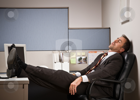 Businessman sleeping at desk with feet up stock photo, Businessman sleeping at desk with feet up by Jonathan Ross