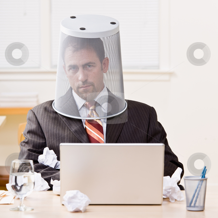 Businessman with trash basket on head stock photo, Businessman with trash basket on head by Jonathan Ross