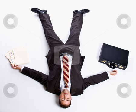 Businessman laying on floor and briefcase stock photo, Businessman laying on floor and briefcase by Jonathan Ross