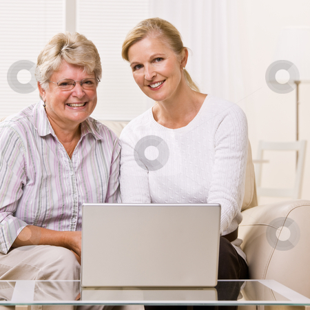 Senior woman and daughter using laptop stock photo, Senior woman and daughter using laptop by Jonathan Ross