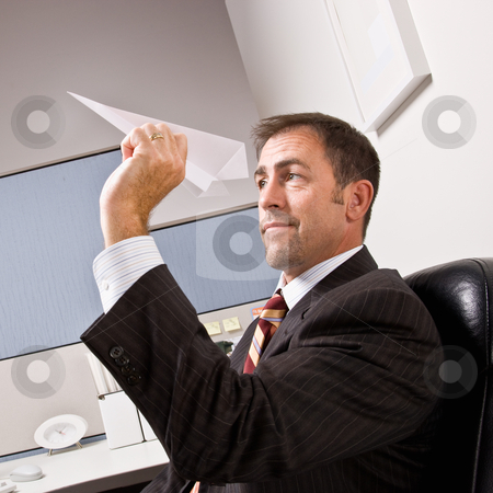 Businessman throwing paper airplane stock photo, Businessman throwing paper airplane by Jonathan Ross
