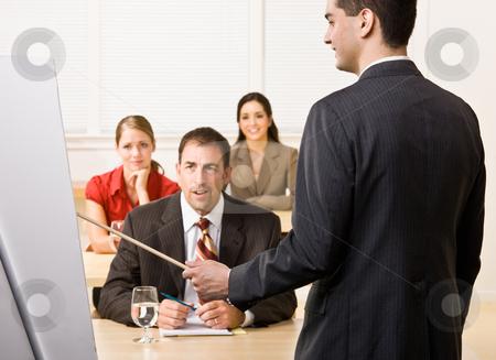 Businessman explaining chart stock photo, Businessman explaining chart by Jonathan Ross